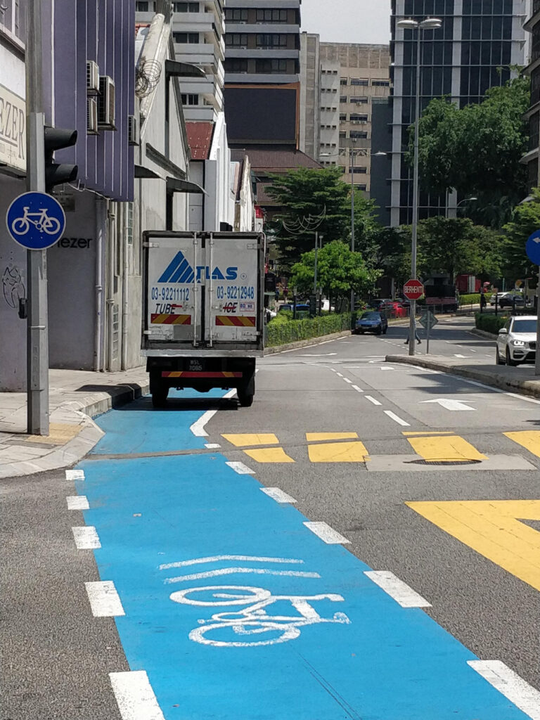 A bike lane is used for parking. Kuala Lumpur, summer 2019.
